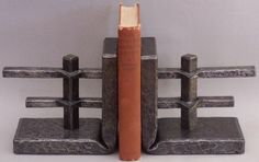 Nigel Tudor, Blacksmith - Hand forged slit and drifted joint bookends