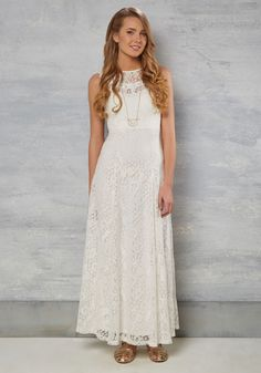 From the moment your eyes open in the morning until the last second spent in this white lace gown, your day is a total dream! Charming scalloped accents detail the illusion neckline of this boho-inspired dress, bringing a true brilliance to your big day.