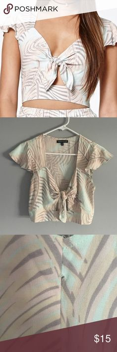 Kendall & Kylie front tie crop top Beautiful 100%rayon crop top size small. Never worn. Tiny hole on side (pictured above) its where the zipper starts so not a real hole just how it's made. Kendall & Kylie Tops Crop Tops