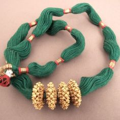 "20ct gold, cotton, Nepal  An original necklace characterized by the green color of the cotton cord and 4 elements in granulation gold 20ct ...an original and rare jewel!  Weight:43,8gr  Lenght:22,047 inch www.halter-ethnic.com...have a look for more info under the item ""necklaces and pendants"""