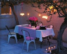 patio dining with candlelight at dusk