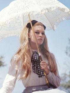 "Sophisticated/princess - bows, umbrella for shade, prissy, poised Brigitte Bardot in ""Viva Maria"", 1965."