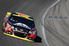 Jeff Gordon, driver of the #24 AXALTA Chevrolet, drives during the NASCAR Sprint Cup Series myAFibRisk.com 400 at Chicagoland Speedway on September 20, 2015 in Joliet, Illinois.