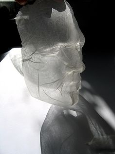 tissue paper sculpture | polly verity Ghost 'masks' of people's faces...?