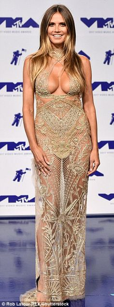 Wow factor: Demi Lovato (left) Paris Jackson (center), and Heidi Klum (right) wore very racy numbers as she hit the red carpet at the MTV Video Music Awards in Los Angeles on Sunday