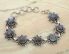 17.50ctw Genuine Labradorite & .925 Sterling Silver Plated Brass Bracelet (SJHB0010LAB) #silverbracelets #braceletsilver #braceletdesigns #sterlingsilverbracelets #silverbraceletsforwomen #braceletsformen #sterlingsilvercharmbracelet #bracelet #personalizedbracelets #gemstonebracelets #handmadebracelets #silvercharmbracelet Buy Now: http://www.sterlingsilverjewelry.tv/genuine-labradorite-silver-plated-brass-link-bracelet-sjhb0010lab.html
