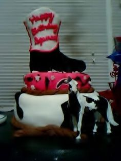 My son's 9th birthday cake! Western themed black and white paint, red bandana with boot topper. My 1st cake I did in fondant!