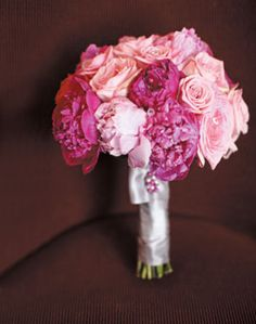 Bouquet of roses, ranunculuses, and peonies in various shades of pink. Photo by Liana Photography #weddings