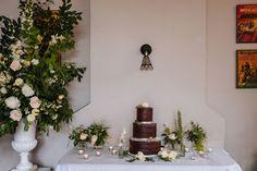 wedding cake chocolate semi naked flowers white florist urn table display decoration brownie cake