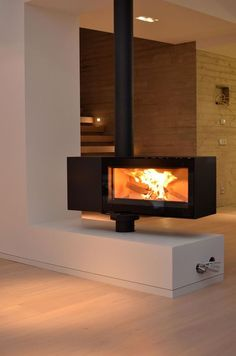 This is good to hold a central wood burner and be a divided at the front door entrance/guest toilet/TV snug and warm the open plan living space. Wood, House Design, Home Fireplace, Living Spaces, House Interior, Wood Burner, Modern Fireplace, Home Interior Design, Open Plan Living