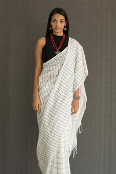 This Black & White checks handwoven saree with hint of pink will add a twist to your day to day saree look. Drape it loose or with neat pleats, it will be fit any work occasion or cocktail party. Pair it with black or silver jewellery of your choice Saree Draping Styles, Saree Styles, Ethnic Fashion, Indian Fashion, Women's Fashion, Indian Dresses, Indian Outfits, Western Outfits, Black And White Saree
