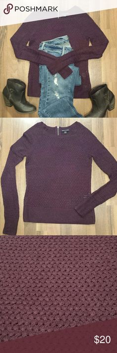 {American Eagle} Sweater The knit of this sweater is unique & gorgeous! 😍 It is super soft and a beautiful dark eggplant/ burgundy color. Has a cute zipper closure in the back. Excellent condition, worn one time, no stains or signs of wear. Generous sizing, could also fit a size small, in my opinion. Please refer to listed measurements.  55% Cotton, 25% Acrylic, 15% Nylon & 5% Wool.  Measurements: Length 22, Bust 16 & Arm Length 24. American Eagle Outfitters Sweaters Crew & Scoop Necks