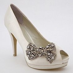 Ivory bridal & wedding shoes designed by Menbur.  Platforms & high heels with crystal accents to dazzle on your special day.