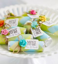"Wedding: Favors: Rolls of mints can be purchased in bulk, dressed up in lightweight patterned paper, and secured with adhesive. Use a digital die-cutting tool to mass-produce the ""Mint to Be"" tags, and tie them on with twine. Adhere a pretty flower embellishment."