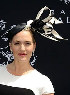 Kate Winslet in France for the Prix de Diane Longines 2014. Wearing a hat by Philip Treacy.