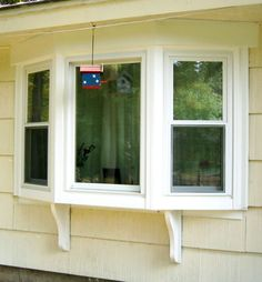 bay window - Google Search - looking particularly at the exterior finishing details and how the top is handled..