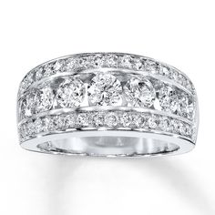Stunning round diamonds rest in the center of this dazzling ring for her. A row of round diamonds flows above and below the center of this fine jewelry ring, set in 14K white gold. This beautiful ring has a total diamond weight of two carats. Diamond Total Carat Weight may range from 1.95 - 2.11 carats.