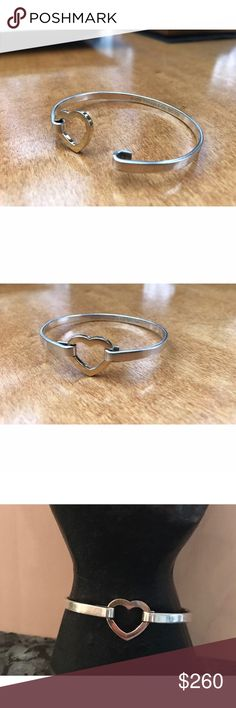🆕 Gold Heart Tiffany & Co Bracelet 🙌🏻 Beautiful Tiffany & Co Silver and 18k gold heart bangle bracelet. 2003. Please feel free to comment with any questions. Tiffany & Co. Jewelry Bracelets
