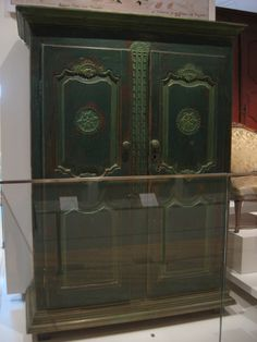 1770-1800 French-Canadian Armoire at the Royal Ontario Museum, Toronto - Even after the British Conquest, many French-Canadian craftsmen continued to use the styles and techniques they were used to.  At first, it might have simply been done out of habit, but this retention of French-influenced furniture styles became part of the French-Canadians' stubborn hold on their own cultural identity.  So for instance, there was a preference for French armoires over British chests of drawers in…