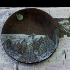 Ceramic painted black then scratched with a screw