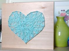 This DIY nail and yarn heart art is a beautiful alternative to a photograph or painting.