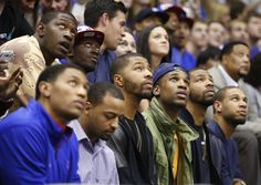 Former Kansas players watch a highlight video from Mario Chalmers' career Texas during a halftime ~ 2.16.13
