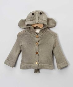 Elephantastic: we're in love with this funky animal jumper, so sweet and lots of fun for your little one! In grey with an elephant hood, this one will make them unforgettably adorable!Button fastening100% organic cottonHand washEach piece is made by hand and signed by the knitter...