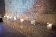 Candles soften the raw exposed brick & concrete at Melrose Market Studios