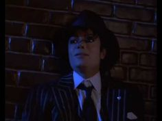 """The finale to the Moonwalker feature film, Michael Jackson's """"Come Together"""" short film features the King of Pop performing The Beatles' No. 1 hit in a conce..."""