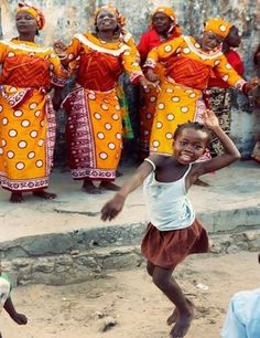 V - Vacation and Recreation! Shown above is a picture of Mozambique citizens having some fun by dancing.