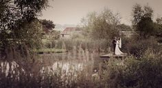 Bride and groom at the Grittenham Barn lake.
