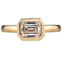 1.01 Carat Emerald Cut Diamond Gold Engagement Ring  | From a unique collection of vintage solitaire rings at https://www.1stdibs.com/jewelry/rings/solitaire-rings/