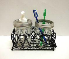 Mason Jar Soap or Lotion Dispenser and Toothbrush Holder Set Bath Caddy. $32.50, via Etsy.
