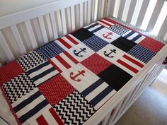 Patchwork Cot / Crib Quilt Made in Australia by SnugglyJacks. Navy red and black anchors nautical. Cot or Crib sizes available. Custom made bedding for all budgets. Fun fresh and funky designs for the modern mum!