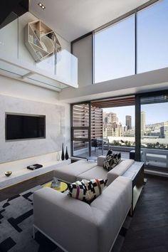Baies vitrées et fenêtres fixes en aluminium pour un duplex design au Cap (Afrique du Sud). Plus de photos sur Côté Maison http://petitlien.fr/828e