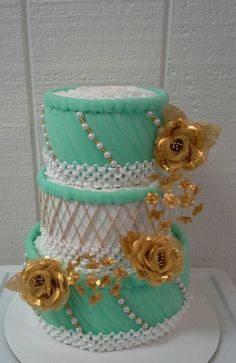 Check out this item in my Etsy shop https://www.etsy.com/listing/255296579/gold-white-mint-green-diaper-cake-themed