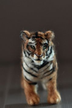 Kate's needle felted tiger. by daria.lvovsky, via Flickr