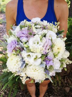 August bridal bouquet featuring white dahlias, white lisianthus, lavender lisianthus, lavender monarda, and lots of fragrant herbs.  Grown and designed by Love 'n Fresh Flowers in Philadelphia.