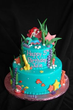 BC frosting with fondant accents and some RI sea creatures, little mermaid is a keepsake.