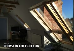Cabrio Velux windows with roof balcony in Hove loft conversion