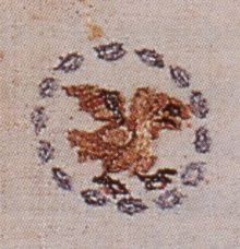 Shirt of Queen Bathilde, who died ca. 680. The shirt was placed into the coffin and imitates with its chainstitch embroidery precious Byzantine jewellery. Executed in silks on linen.