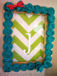 The rosettes are a little much but I like the idea of using fabric for a background with a wooden letter as the monogram.
