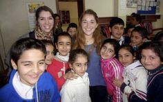 Emma Goodman '14 (right) and a DIS classmate visit a school of predominately Kurdish children in Istanbul, Turkey, where the pair spent their study tour. Goodman, who is studying abroad in Copanhagen, and the students asked each other questions about school and their daily lives.