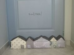 draft excluder houses grey: