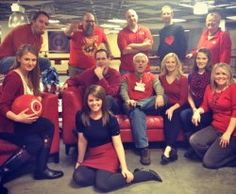 A few associates of Associated sporting red gear in support of National Wear Red Day for women's heart health.