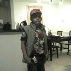 Prod when he wz lil and he had a flip phone. Cute lol