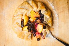 My friend Terryl makes a fancy version of this by making her own dough from scratch. Ok - so mine isn't from scratch, but it sure is good. Ingredients * 1 supermarket ready pie crust, uncooked * 2 ripe peaches, sliced in about 16 wedges each * 1 small basket blueberries * ze