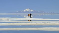 Uyuni Salt Flats in Bolivia - From beaches to jungles to deserts, here are 50 places in Latin America for your bucket list.