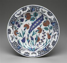 DISH WITH CARNATIONS, TULIPS, ROSES, AND SAZ LEAF (Turkish)  Date     1560/1585 Medium     Underpainted, glazed fritware