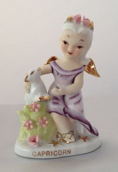 Vintage Lefton Capricorn horoscope girl figurine